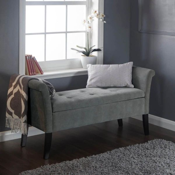 Grey deep buttoned window seat with storage underneath