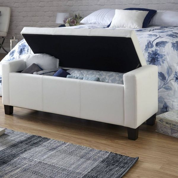 White faux leather storage ottoman with padded liftable top, high sides and black square legs