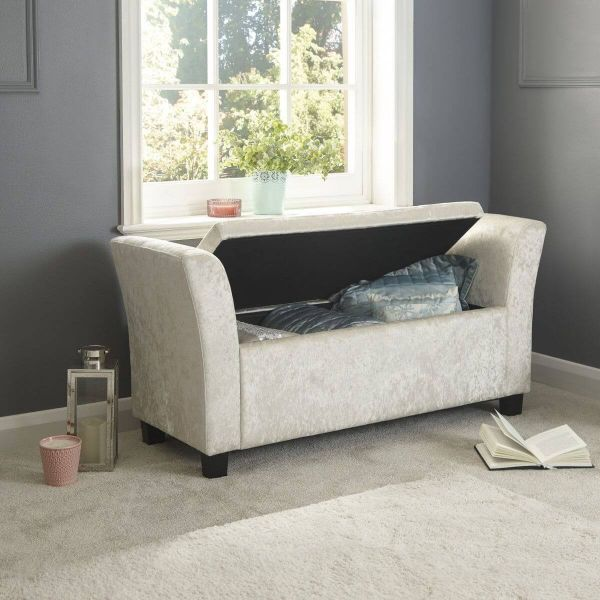 Oyster coloured window seat with liftable padded top, with high curved sides