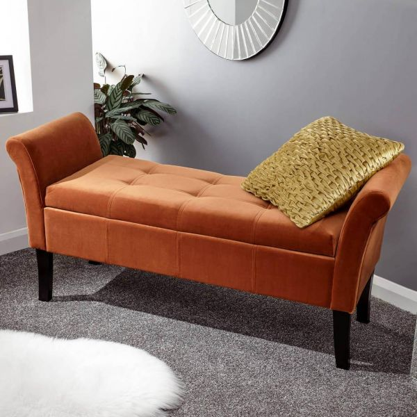 Russet window seat with deep button detail and dark legs