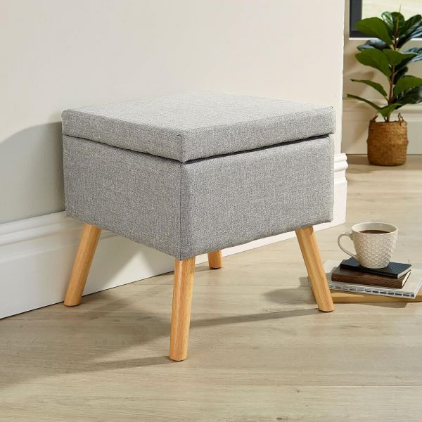 Small light grey ottoman with wooden frame and legs