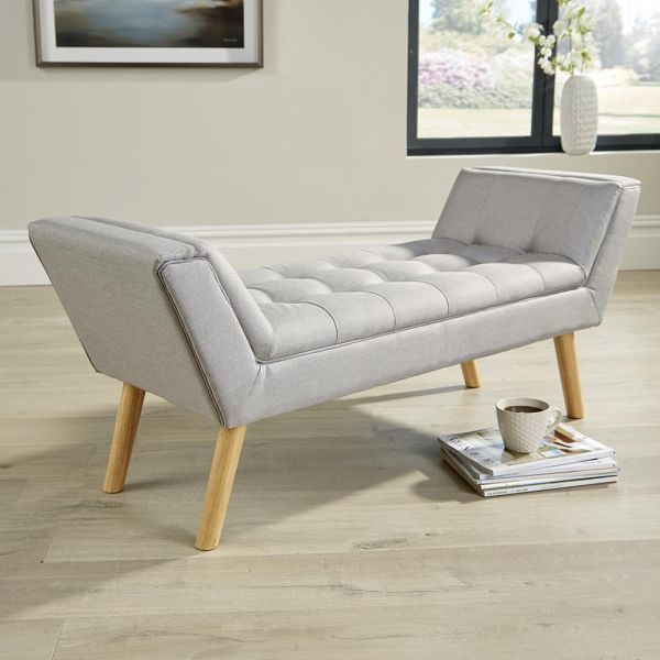 Classy light grey upholstered window bench with four wooden legs and extra seating