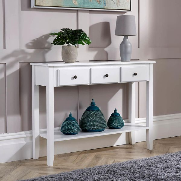 white painted wood 3 drawer console table with black metal knob handles and under shelf
