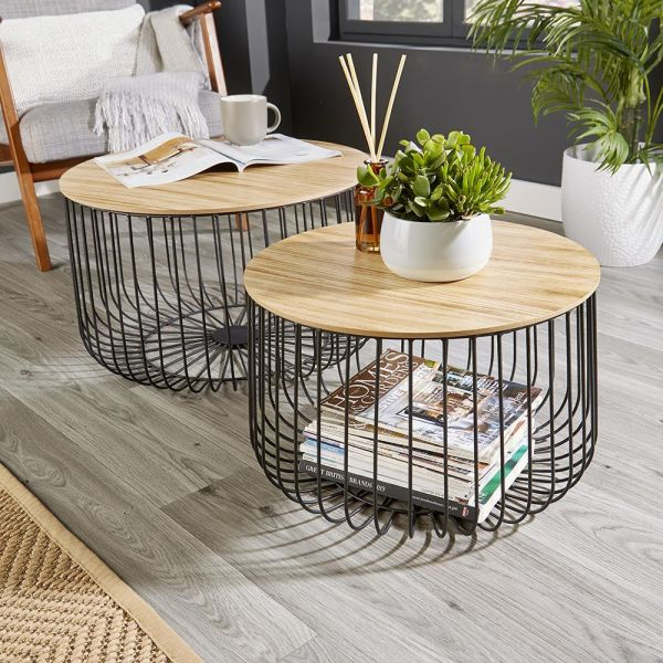 2 Drum size tables have a birdcage base of vertical bars made from black metal and wooden top