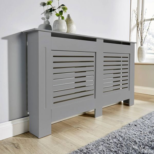 Large slatted front grey radiator cover, front side view